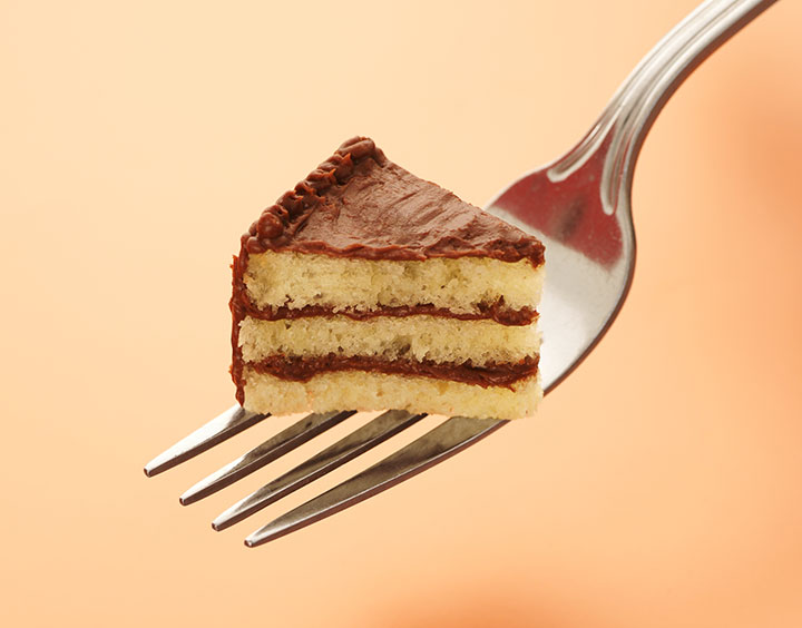 An image of a tiny piece of chocolate cake on a fork
